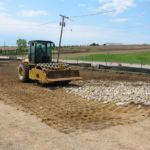 photo of roller compacting large stone aggregate