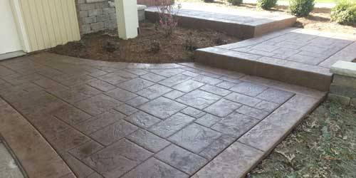 finished photo of stamped concrete pathway and steps